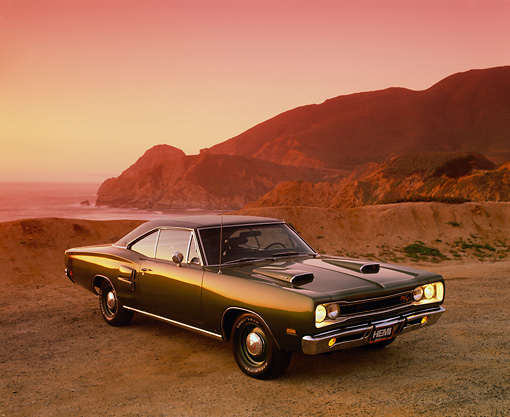 AUT 22 RK1501 05 © Kimball Stock 1969 Dodge Hemi Coronet RT Green 3/4 Front View On Sand By Ocean And Rocks Filtered
