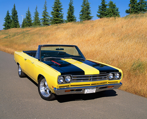 AUT 22 RK1516 03 © Kimball Stock 1969 Plymouth Road Runner Convertible Yellow And Black Front 3/4 View On Pavement By Dry Grass