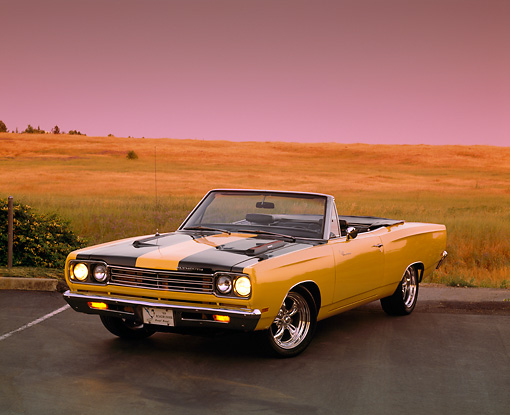 AUT 22 RK1517 09 © Kimball Stock 1969 Plymouth Road Runner Convertible Yellow And Black Front 3/4 View On Pavement