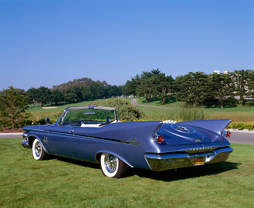 AUT 22 RK1558 02 © Kimball Stock 1961 Imperial Crown Convertible Blue 3/4 Rear View On Grass Blue Sky