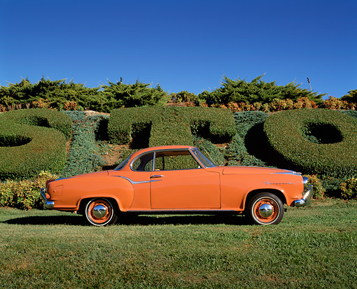 AUT 22 RK1602 01 © Kimball Stock 1960 Borgward Isabella Coupe Orange Profile View On Grass