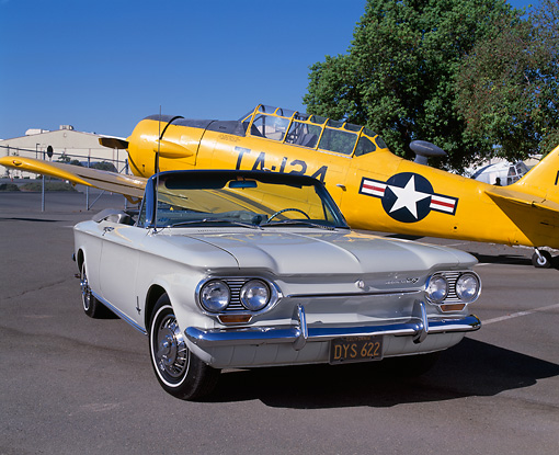 AUT 22 RK1608 05 © Kimball Stock 1963 Corvair Monza Convertible White 3/4 Front View On Pavement By Yellow Airplane