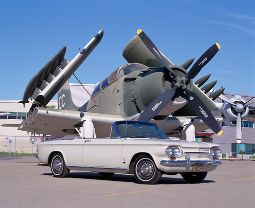AUT 22 RK1611 03 © Kimball Stock 1963 Corvair Monza Convertible White Low 3/4 Side View On Pavement By Military Airplane