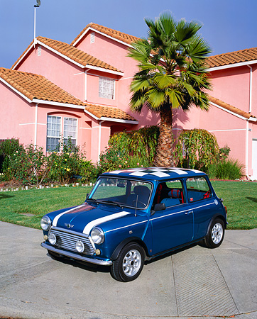 AUT 22 RK1627 02 © Kimball Stock 1969 Austin Mini Cooper Blue And White 3/4 Front View On Pavement By House