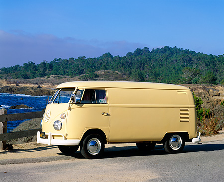 AUT 22 RK1629 01 © Kimball Stock 1965 VW Panel Van Yellow 3/4 Front View On Pavement Water And Trees Background