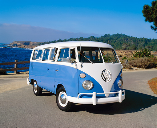 AUT 22 RK1637 01 © Kimball Stock 1967 Volkswagen Split Window Bus Blue And White 3/4 Front View On Pavement Water And Trees Background