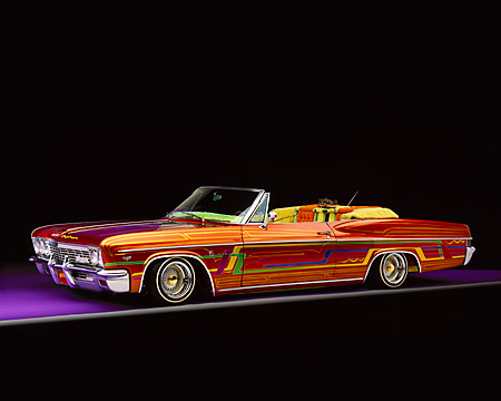 AUT 22 RK1658 05 © Kimball Stock 1966 Chevrolet Impala Lowrider Convertible Multicolored 3/4 Front View Studio