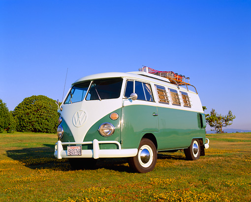 AUT 22 RK1749 01 © Kimball Stock 1965 Volkswagen Westfalia Camper Green And White Low 3/4 Front View On Grass Blue Sky