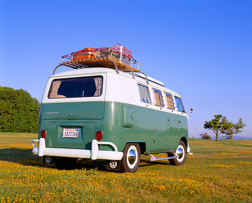 AUT 22 RK1750 03 © Kimball Stock 1965 Volkswagen Westfalia Camper Green And White Low Rear View On Grass Blue Sky