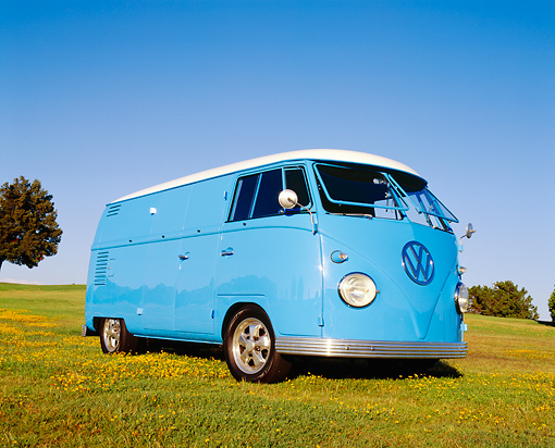 AUT 22 RK1768 04 © Kimball Stock 1962 Volkswagen Custom Bus Light Blue Low 3/4 View On Grass Blue Sky