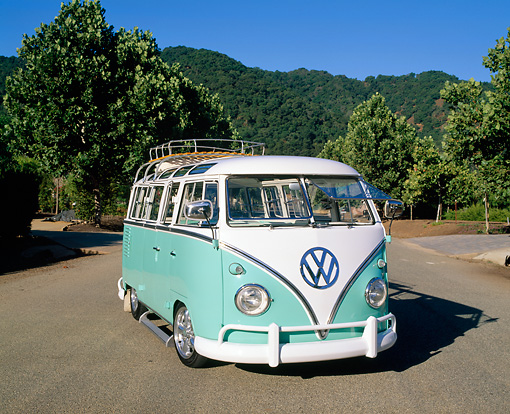 AUT 22 RK1785 02 © Kimball Stock 1960 Volkswagen Deluxe 23-Window Microbus Seafoam And White 3/4 Front View By Mountains Trees
