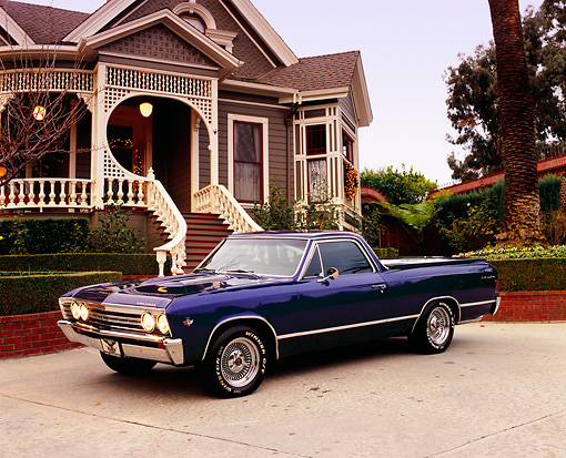 AUT 22 RK1879 02 © Kimball Stock 1967 Chevrolet El Camino Blue 3/4 Front View On Pavement By House Filtered