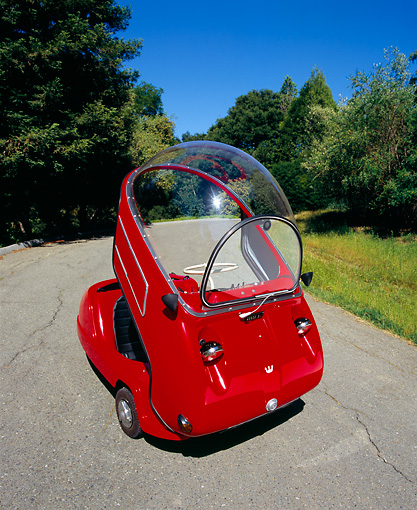 AUT 22 RK1942 03 © Kimball Stock 1964 Peel Trident Microcar Red 3/4 Front View On Pavement By Trees