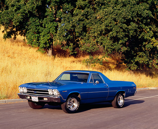 AUT 22 RK1972 01 © Kimball Stock 1969 Chevrolet El Camino Blue 3/4 Front View On Pavement By Trees