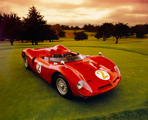 AUT 22 RK1984 02 © Kimball Stock 1967 Bizzarrini P538 Can-Am Le Mans Sports Car Red 3/4 Front View On Grass Wide Angle