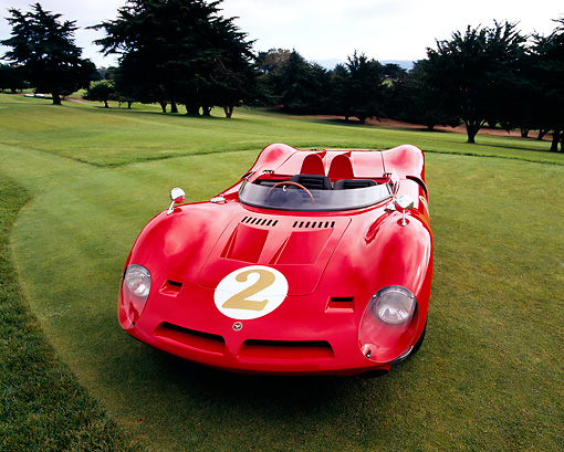 AUT 22 RK1986 02 © Kimball Stock 1967 Bizzarrini P538 Can-Am Le Mans Sports Car Red 3/4 Front View On Grass