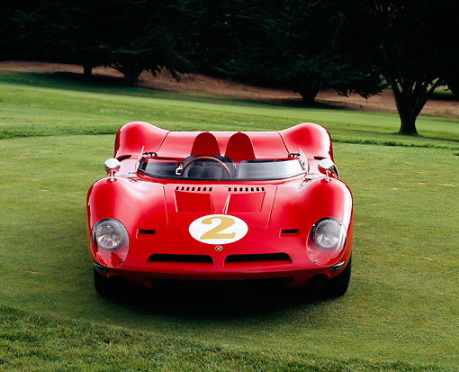 AUT 22 RK1987 03 © Kimball Stock 1967 Bizzarrini P538 Can-Am Le Mans Sports Racer Red Head On View On Grass