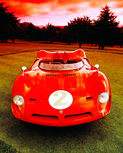AUT 22 RK1998 04 © Kimball Stock 1967 Bizzarrini P538 Cam Am Le Mans Sport Racer Red Head On Shot On Grass
