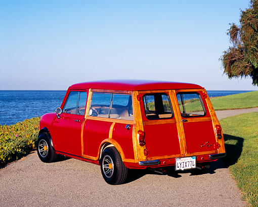 AUT 22 RK2002 02 © Kimball Stock 1962 Austin Mini Traveller Woody Red White Stripes 3/4 Rear View On Pavement By Water