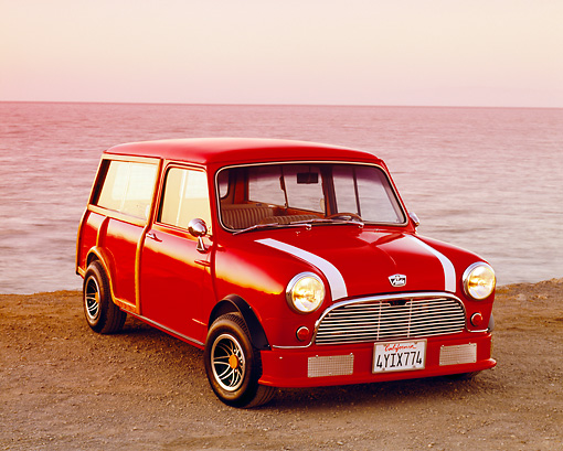 AUT 22 RK2003 01 © Kimball Stock 1962 Austin Mini Traveller Woody Red White Stripes 3/4 Front View On Sand By Water