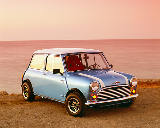 AUT 22 RK2010 01 © Kimball Stock 1962 Morris Mini 850 Blue White Stripe 3/4 Front View On Sand By Water