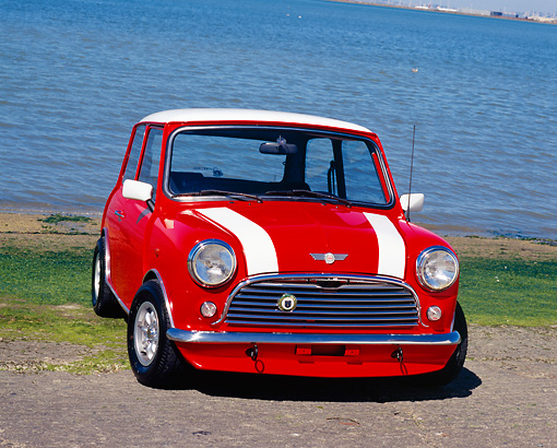AUT 22 RK2021 01 © Kimball Stock 1968 Austin Mini Cooper MKI Orange White Stripes 3/4 Front View On Pavement By Water