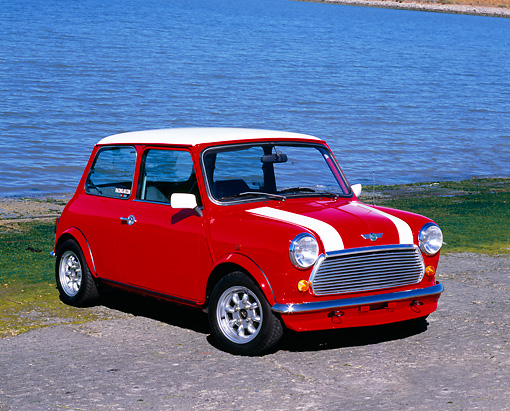 AUT 22 RK2040 01 © Kimball Stock 1969 Austin Mini Cooper Mk III Red With White Stripes 3/4 Front View On Pavement By Water