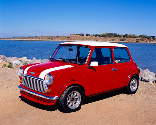 AUT 22 RK2042 01 © Kimball Stock 1969 Austin Mini Cooper MKIII Red White Stripes 3/4 Side View On Sand By Water