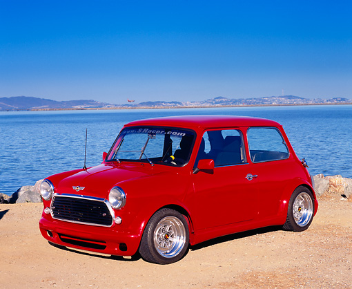 AUT 22 RK2044 05 © Kimball Stock 1969 Austin Mini Cooper Red Side 3/4 View On Sand By Water