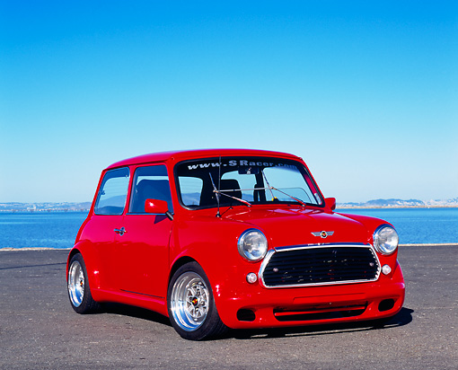 AUT 22 RK2045 05 © Kimball Stock 1969 Austin Mini Cooper Custom Red 3/4 Front View On Pavement By Water