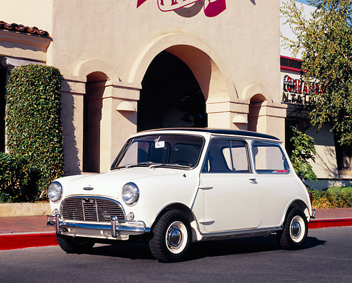 AUT 22 RK2054 02 © Kimball Stock 1966 Austin Mini Cooper S White Black Top 3/4 Side View On Pavement By Building