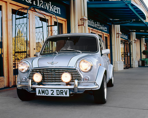 AUT 22 RK2061 02 © Kimball Stock 1969 Rover Mini Silver White Stripe 3/4 Front View On Pavement