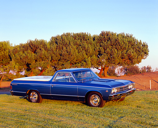 AUT 22 RK2071 04 © Kimball Stock 1967 Chevrolet El Camino Blue 3/4 Side View On Grass Trees Background
