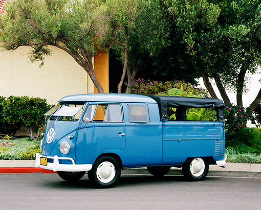 AUT 22 RK2072 06 © Kimball Stock 1960 VW Double Cab Can Dove Blue 3/4 Side View On Pavement By Tree And Bushes