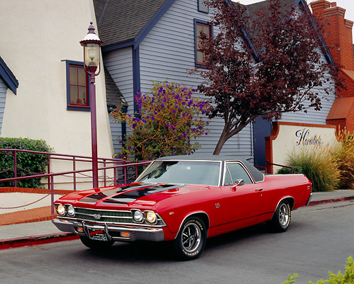 AUT 22 RK2076 04 © Kimball Stock 1969 Chevy El Camino Red Black Stripe 3/4 Front View On Pavement By House