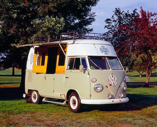 AUT 22 RK2092 02 © Kimball Stock 1967 Volkswagen High Roof Bus Gray And White 3/4 Front View On Grass By Trees