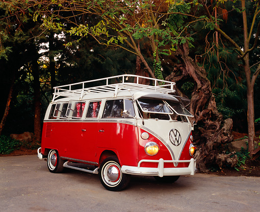 AUT 22 RK2094 02 © Kimball Stock 1964 Volkswagen 13 Window Deluxe Bus Red And White Side 3/4 View On Pavement By Trees