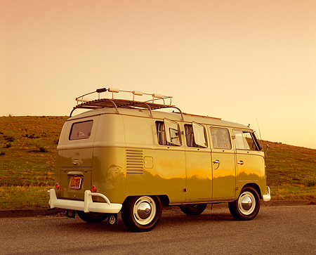 AUT 22 RK2102 03 © Kimball Stock 1961 Volkswagen Westfalia Camper Green 3/4 Low Rear View On Pavement By Hill