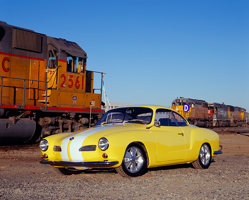 AUT 22 RK2123 01 © Kimball Stock 1961 VW Karmann Ghia Yellow White Stripe 3/4 Front View On Gravel By Train