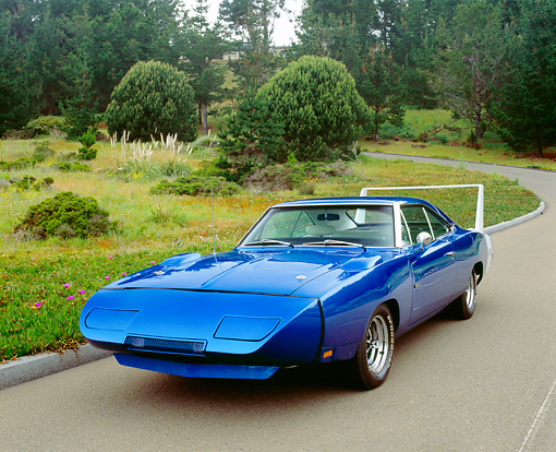 AUT 22 RK2150 01 © Kimball Stock 1969 Dodge Daytona Charger Blue 3/4 Front View On Pavement By Bushes