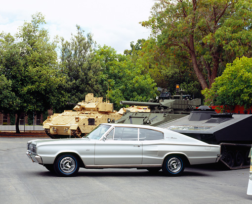 AUT 22 RK2171 05 © Kimball Stock 1966 Dodge Hemi Charger Silver Gray 3/4 Front View On Pavement By Tanks