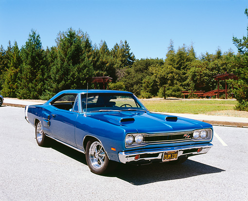 AUT 22 RK2177 01 © Kimball Stock 1969 Dodge Coronet R/T Blue 3/4 Front View On Pavement By Trees