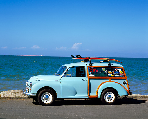 AUT 22 RK2235 01 © Kimball Stock 1967 Morris Minor 1000 Traveller Light Blue 3/4 Front View On Pavement By Water