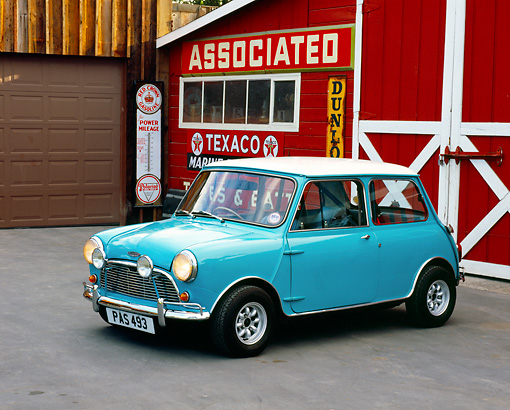 AUT 22 RK2246 02 © Kimball Stock 1962 Austin Mini Cooper Light Blue 3/4 Side View By Barn