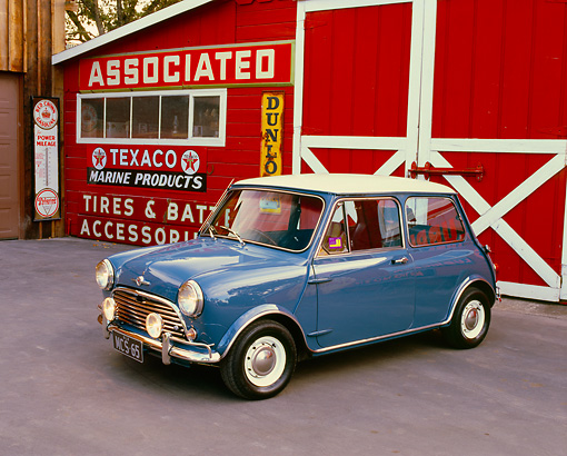 AUT 22 RK2249 02 © Kimball Stock 1965 Morris Mini Cooper Blue And White 3/4 Front View On Pavement By Barn Station