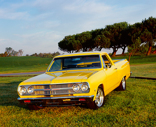 AUT 22 RK2286 02 © Kimball Stock 1965 Chevrolet, El Camino, Yellow 3/4 Front View On Grass