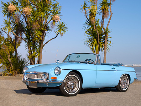 AUT 22 RK2327 01 © Kimball Stock 1965 MG MGB Convertible Iris Blue Low 3/4 Side View On Pavement