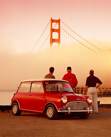 AUT 22 RK2367 01 © Kimball Stock 1967 Austin Mini Cooper S Red And White 3/4 Front View By Golden Gate Bridge With People