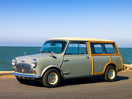 AUT 22 RK2368 01 © Kimball Stock 1965 Morris Mini Minor Traveller Woody Gray 3/4 Side View On Pavement By Water