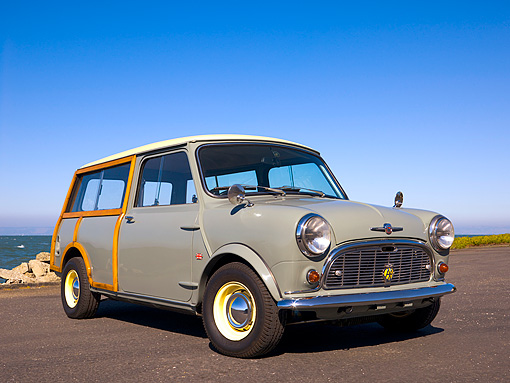 AUT 22 RK2374 01 © Kimball Stock 1965 Morris Mini Minor Traveller Woody Gray 3/4 Low Front View On Pavement By Water